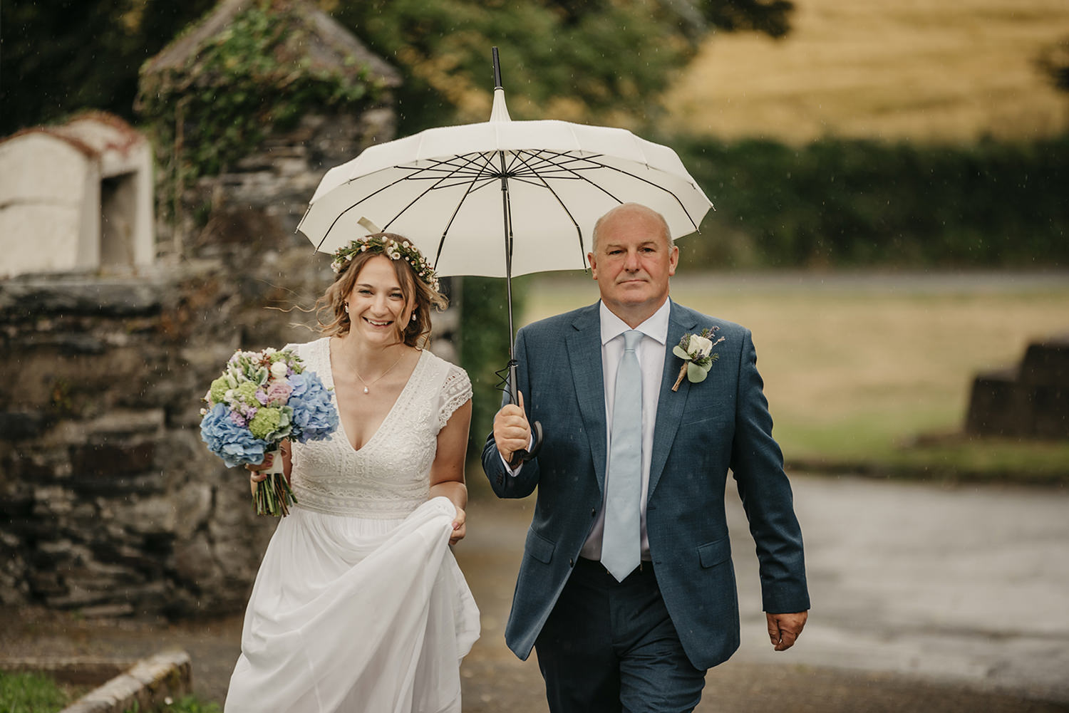 Bride and her dad walking to the Maughold church