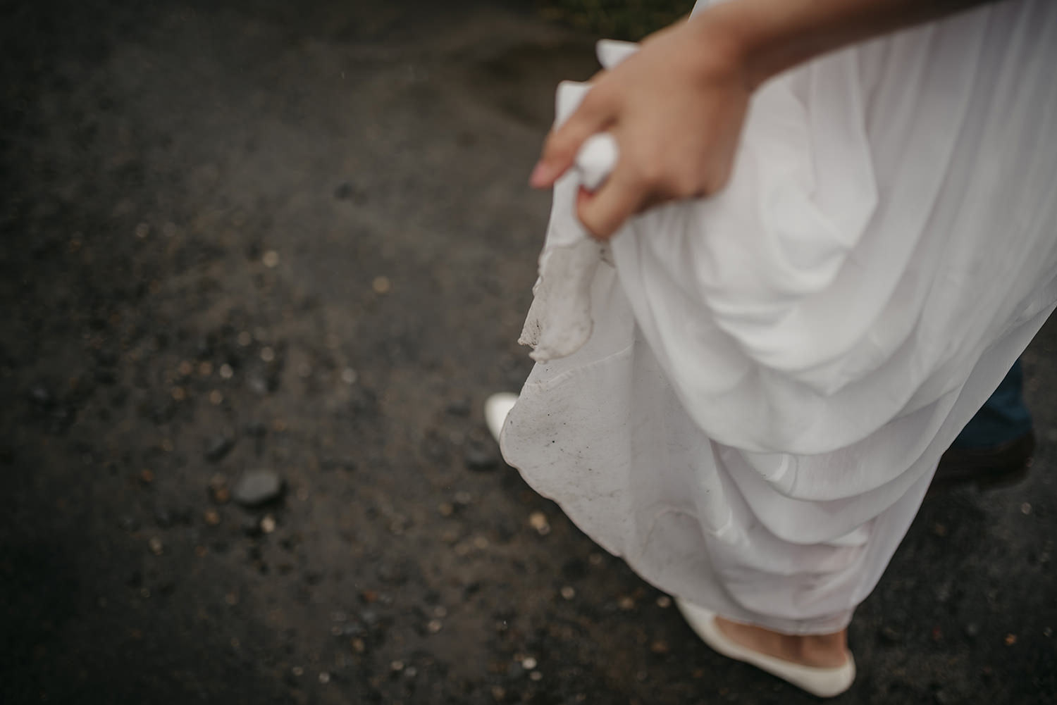 The bride's dress got a bit muddy, but it didn't worry her