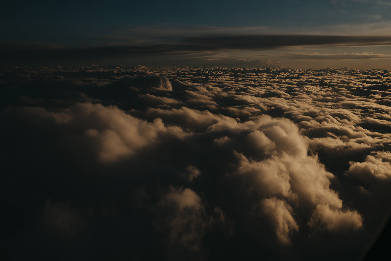 Flying above the clouds to Isle of Man at sunset