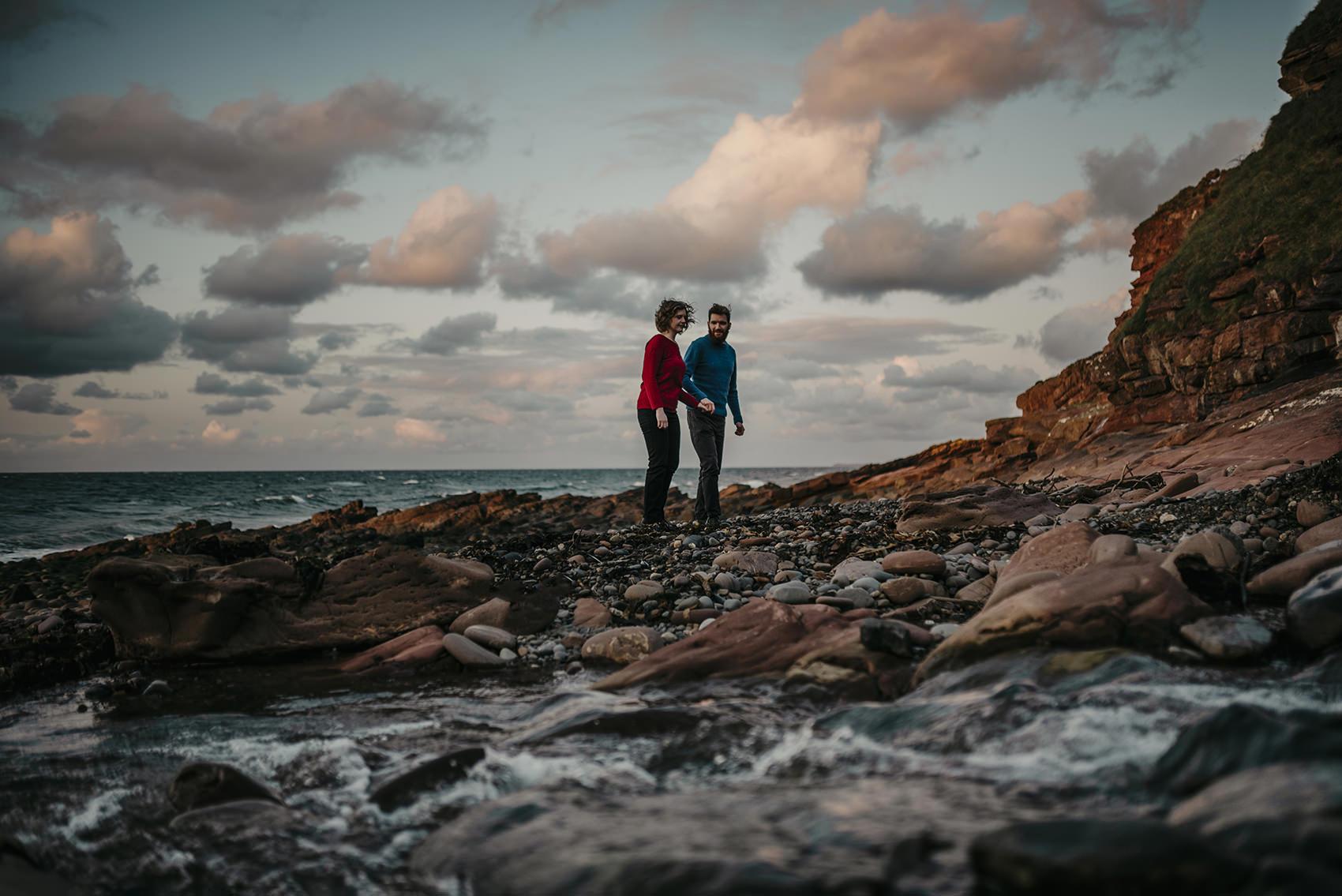windswept sunset engagement photoshoot on a beach near Peel, Isle of Man