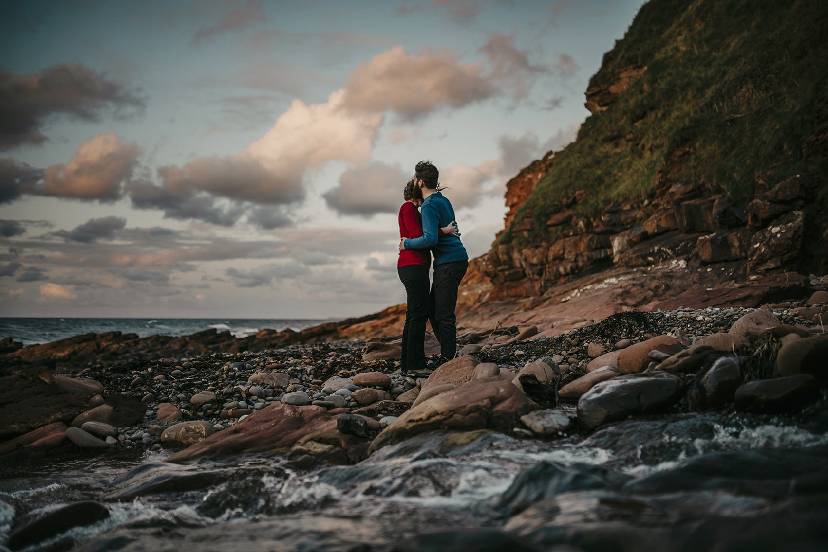 windswept sunset engagement photoshoot on a beach in  Isle of Man