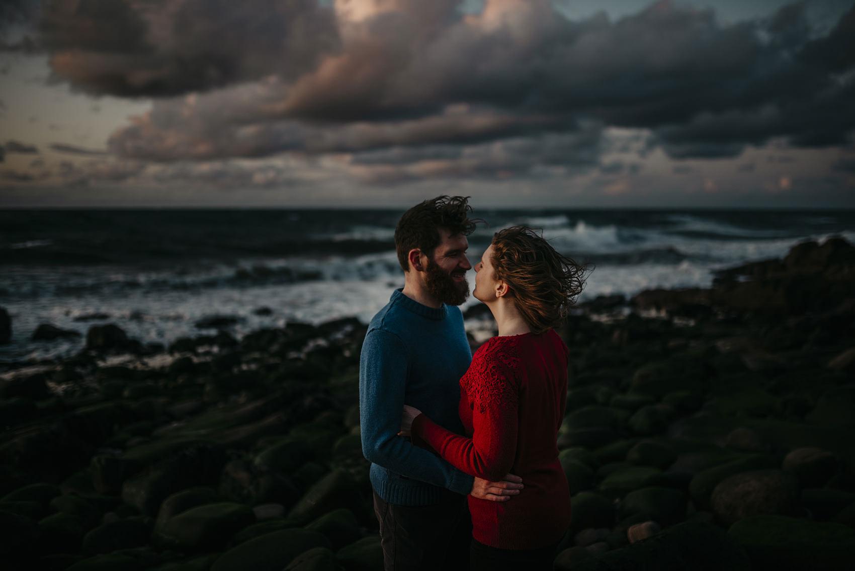 windswept sunset engagement photoshoot on a beach