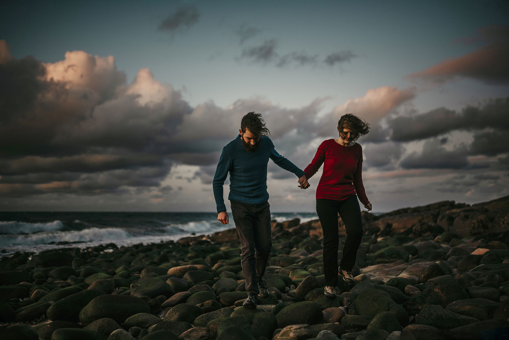 dramatic beach near Peel with a couple holding hands