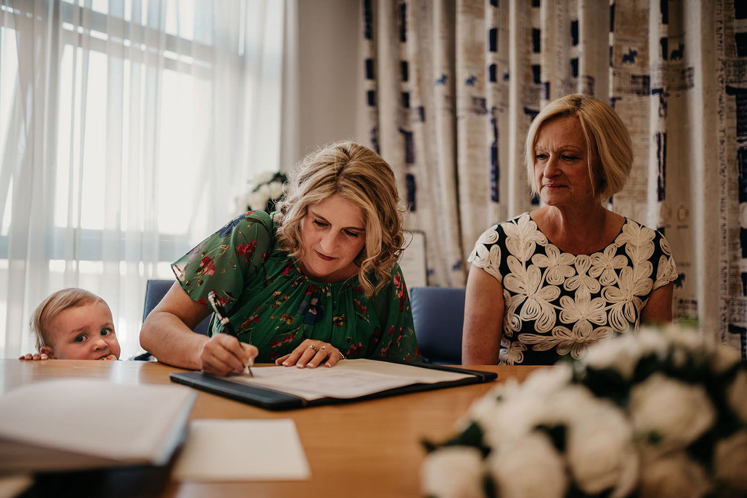 Witnesses signing the wedding contract