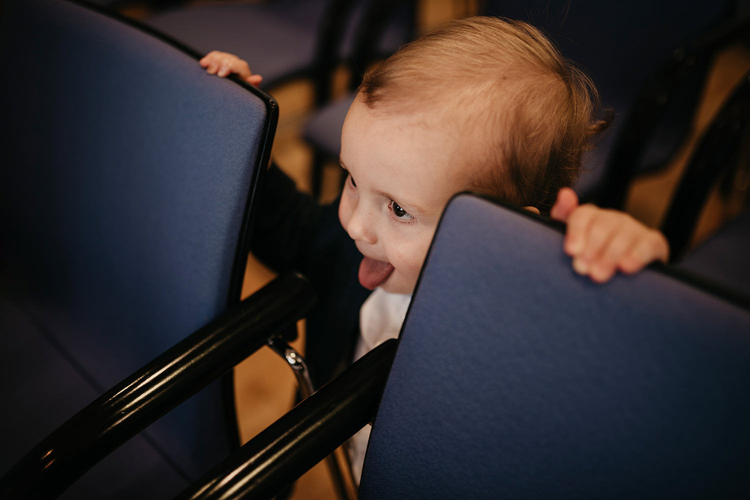 Peeking through chairs and mummy and daddy