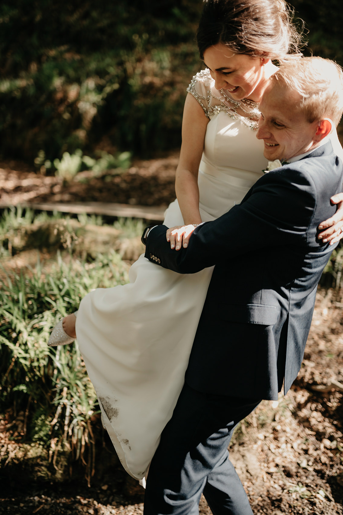 Ross carrying his bride over muddy puddles