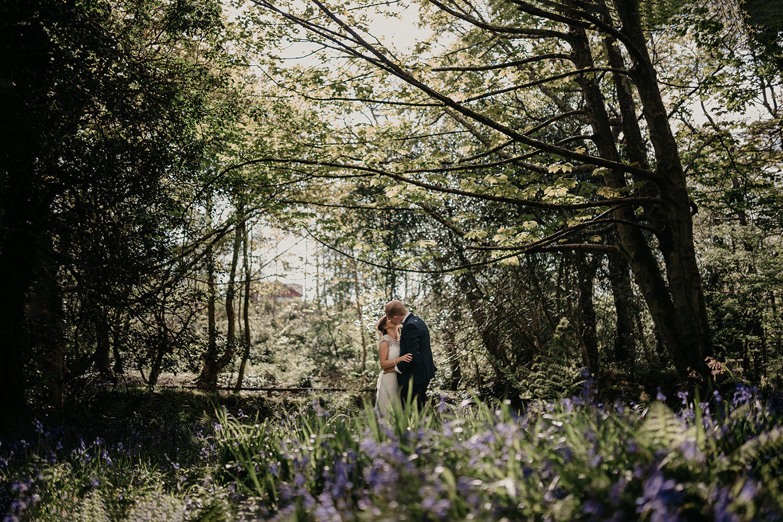 Wedding photos in bluebells in Groudle Glen