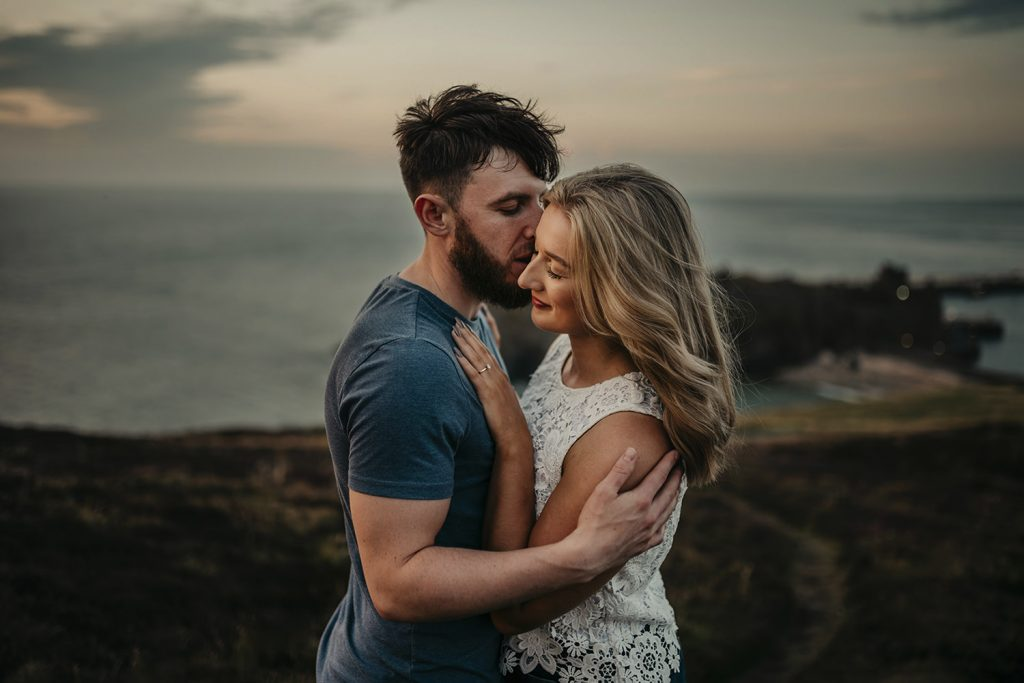 Couple's engagement photo on Peel Hill with Peel castle in the background