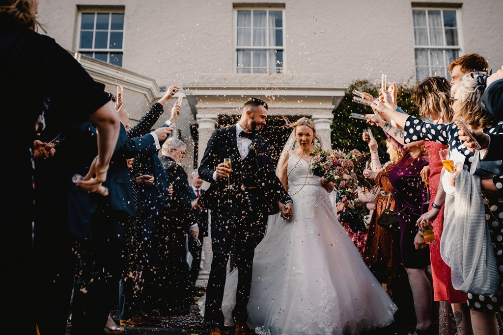 Confetti toss at Rushen Abbey Restaurant wedding