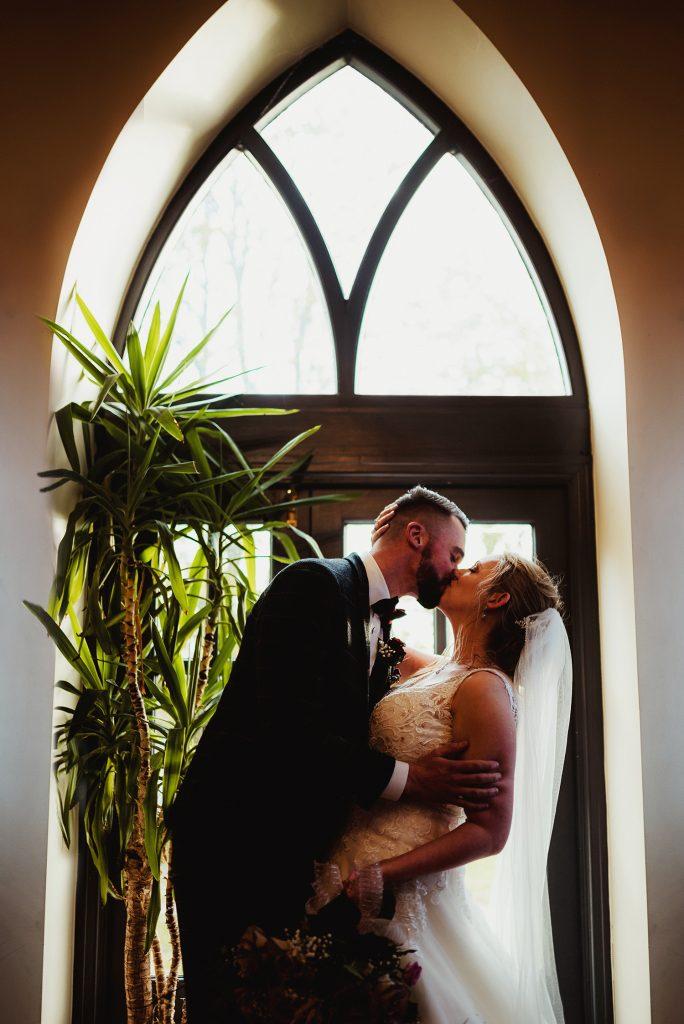 First kiss at Rushen Abbey Restaurant wedding