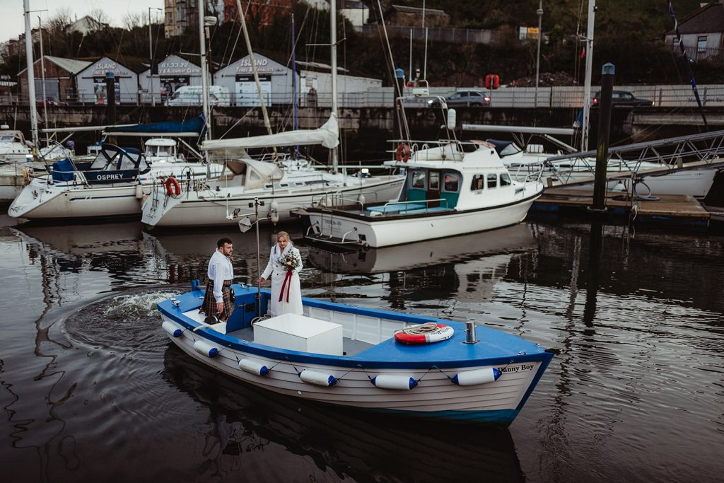 Just married couple in a boat in Douglas harbour