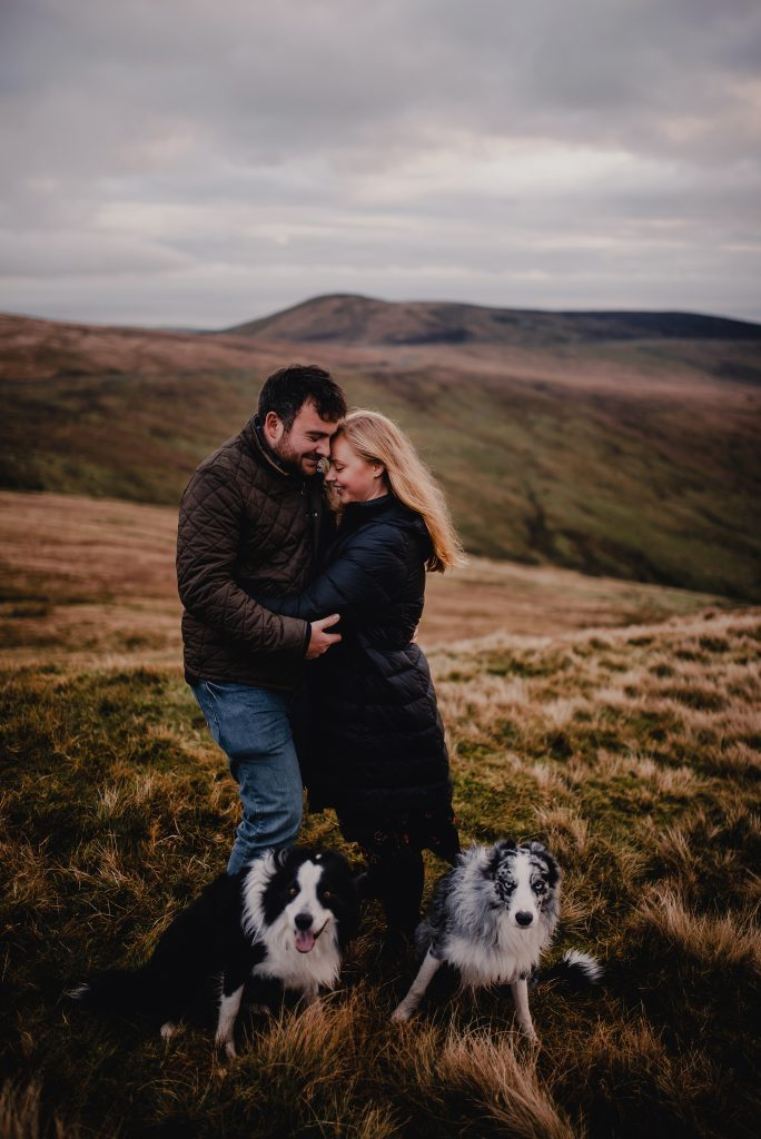 Engagement photo with dogs in mountains