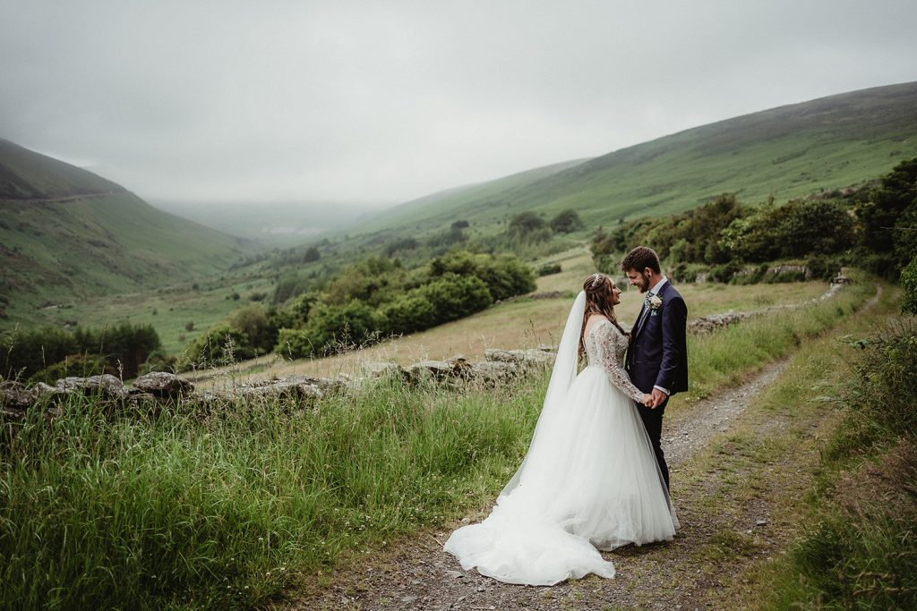 Bride and groom at Agneash with a view of the cloudy Snaefell